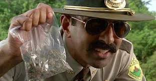 super-troopers-cop-holding-bag-weed